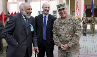 Outgoing Commander of Resolute Support forces and United States forces in Afghanistan, U.S. Army General John Campbell (R) and acting Afghan Defence Minister Mohammad Masoom Stanekzai (L) laugh during a change of command ceremony in Resolute Support headquarters in Kabul, Afghanistan March 2, 2016. REUTERS/Rahmat Gul/Pool - RTS8WRA
