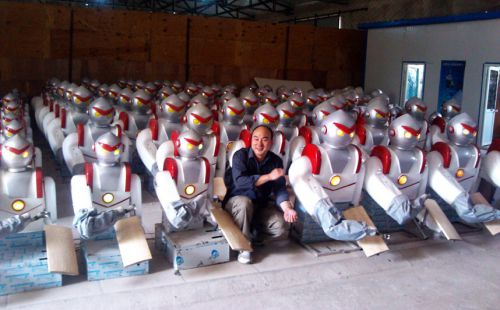 """Man sets up factory to mass produce noodle robots, Beijing, China - 23 Aug 2012...Mandatory Credit: Photo by Quirky China News / Rex Features (1824822c)  Cui Runquan with some of the noodle robots  Man sets up factory to mass produce noodle robots, Beijing, China - 23 Aug 2012  A Chinese chef has set up a company to mass produce noodle robots and claims to have already sold 3,000 units. Cui Runquan came up with the robot idea in 2006 when he was a noodle chef in a restaurant in Beijing. Cui designed and made the robot himself after several months of research and repeated experiments. The robot is able to slice 130 noodles a minute - much faster than a human. Cui comments: """"It doesn't need salary or rest. By pressing a button it can serve you all the time. It's the best worker"""