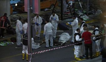 epa05396931 Crime scene investigators work next to a body after a suicide bomb attack at Ataturk Airport in Istanbul, Turkey, 28 June 2016. At least 10 people were killed and scores injured in two separate explosions that hit Ataturk Airport.  EPA/SEDAT SUNA