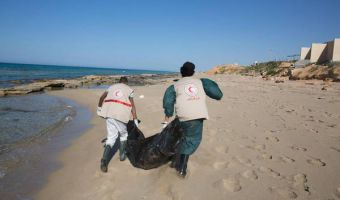 Libyan Red Crescent recovering bodies of drowned migrants from under the sand, on the beach in the Gasr Garabulli, eastern of the city of Tripoli, Libya, 29 March 2016.           ANSA /STR
