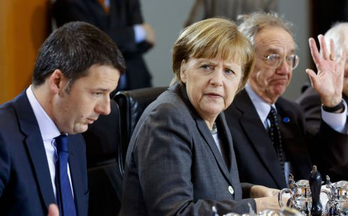 From left, the Prime Minister of Italy Matteo Renzi, German Chancellor Angela Merkel, Italian Finance Minister Pier Carlo Padoan and German Finance Minister Wolfgang Schaeuble attend the German and Italian government consultations at the chancellery in Berlin, Monday, March 17, 2014. (AP Photo/Markus Schreiber).
