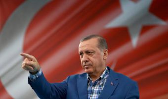 """Turkey's President Recep Tayyip Erdogan addresses a rally in Gaziantep, Turkey, Sunday, Aug. 28, 2016. Erdogan said a 14 year-old suicide bomber was responsible for last weekend's explosion in Gaziantep that claimed dozens lives. Erdogan, speaking at a rally, says the city saw terror's worst when """"DAESH attacked with a suicide bomber,"""" using the Arabic acronym for the Islamic State group and adds that 34 children died in the attack.(Yasin Bulbul, Presidential Press Service, Pool via AP)"""