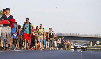 migranti marcia