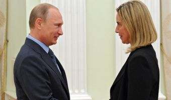 Russian President Vladimir Putin, left, greets Italian Foreign Minister Federica Mogherini, during their meeting in the Kremlin in Moscow, Russia, Wednesday, July 9, 2014. (AP Photo/RIA-Novosti, Mikhail Klimentyev, Presidential Press Service)