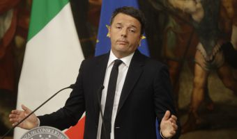 Italian Premier Matteo Renzi speaks during a press conference at the premier's office Chigi Palace in Rome, early Monday, Dec. 5, 2016. Renzi acknowledged defeat in a constitutional referendum and announced he would resign on Monday. Italians voted Sunday in a referendum on constitutional reforms that Premier Matteo Renzi has staked his political future on. (AP Photo/Gregorio Borgia)