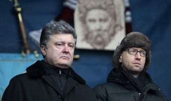 Ukrainian lawmaker and opposition leader Petro Poroshenko,left, and Ukrainian opposition leader Arseniy Yatsenyuk  attend a rally in the Independence Square in Kiev, Ukraine, Sunday, Feb. 9, 2014. UkraineÕs security agency on Sunday warned of a heightened risk of terrorism, including from the anti-government protests. The warning raised the pressure on the opposition as parliament tries to find a way out of the crisis. (AP Photo/Sergei Chuzavkov)