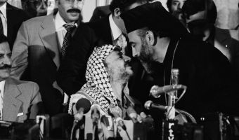 "15 Sep 1979, Madrid, Spain --- Palestine Liberation Organization leader Yasser Arafat greets Greek Catholic archbishop of Jerusalem Hilarion Capucci during an official visit to Madrid. Arafat declared that ""Arabs have the right to use oil as a weapon since Israel uses all its military potential against the PLO."" Capucci was arrested in 1974 after smuggling arms into Israel for terrorists. 