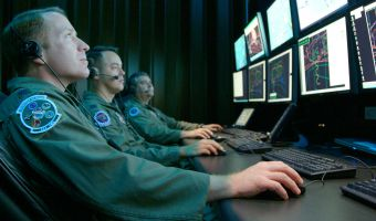 Lt. Col. Tim Sands (from left), Capt. Jon Smith and Lt. Col. John Arnold monitor a simulated test April 16 in the Central Control Facility at Eglin Air Force Base, Fla. They use the Central Control Facility to oversee electronic warfare mission data flight testing. Portions of their missions may expand under the new Air Force Cyber Command. Colonel Sands is the 53th Electronic Warfare Group AFCYBER Transition Team Chief, Captain Smith is the 36th Electronic Warfare Squadron Suppression of Enemy Air Defensestest director, and Colonel Arnold is the 36th Electronic Warfare Squadron commander. (U.S. Air Force photo/Capt. Carrie Kessler)