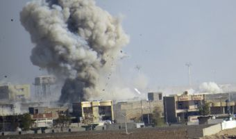 Smoke rises from Islamic State positions following a U.S.-led coalition airstrike during a military operation launched by Iraq Anti-terrorism forces to regain control the western suburbs of Ramadi, the capital of Iraq's Anbar province, 70 miles (115 kilometers) west of Baghdad, Iraq, Saturday, Nov. 14, 2015. (AP Photo/Osama Sami)