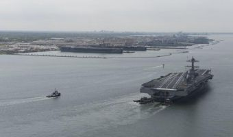 "This US Navy handout photograph shows the future USS Gerald R. Ford (CVN 78) arriving at Naval Station Norfolk in Virginia on April 14, 2017 approaching its berth next to the Nimitz-class aircraft carriers USS Dwight D. Eisenhower (CVN 69) and USS George Washington (CVN 73) after returning from Builder's Sea Trials and seven days underway.  During this initial at-sea period, Ford's crew, representatives from Huntington Ingalls Industries-Newport News Shipbuilding, the Navy's CVN 78 Program Office, the Navy's Supervisor of Shipbuilding, Conversion and Repair and various technical subject matter experts demonstrated many of the ship's key systems. Primary risk reduction objectives were successfully met, and, as is typical with sea trials, the Navy and shipbuilder learned a great deal about the ship's performance during the extensive testing. Analysis continues, and any identified corrective actions will be addressed. CVN 78 remains on track to conduct Acceptance Trials and delivery to the Navy this spring.  / AFP PHOTO / Navy Office of Information / MC2 Ridge Leoni / XGTY  == RESTRICTED TO EDITORIAL USE  / MANDATORY CREDIT:  ""AFP PHOTO / US NAVY /  MC2 RIDGE LEONI"" / NO MARKETING / NO ADVERTISING CAMPAIGNS /  DISTRIBUTED AS A SERVICE TO CLIENTS  =="