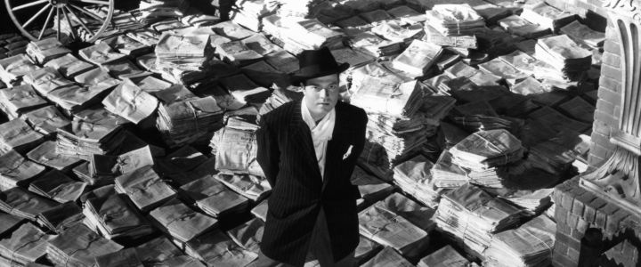 Orson Welles standing on stacks of newspapers in a scene from the film 'Citizen Kane', 1941. (Photo by RKO Radio Pictures/Getty Images)